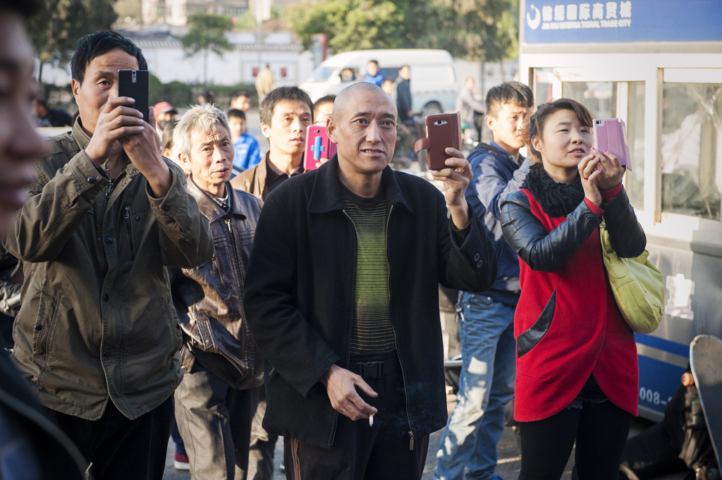 Cell_Phone_Posse_Xi'an_CHINA_2014_OMEALLY